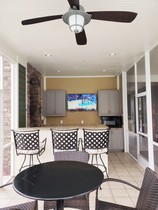 Enclosed outdoor kitchen with TV and electric grill