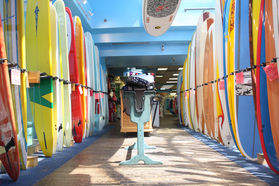 Some of the surfboards for sale on the second floor.